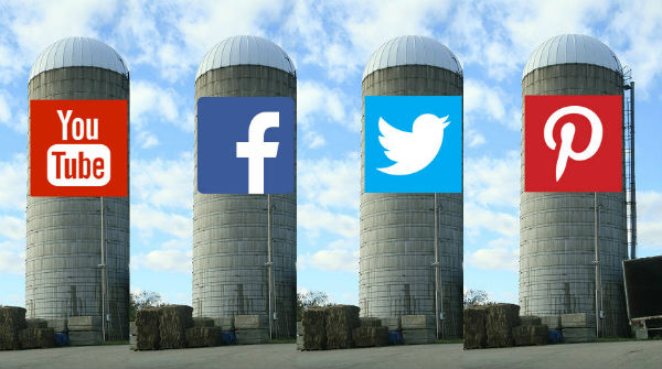 Four silos representing the social media networks Facebook, Twitter, Youtube and Pinterest